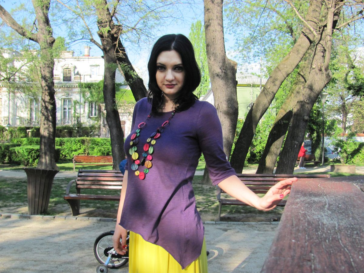 Girl wearing purple and yellow