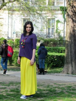 Young woman wearing purple and yellow outfit