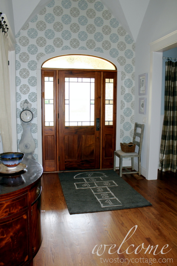 Two Story Foyer Quiz : Two story cottage feature unexpected elegance