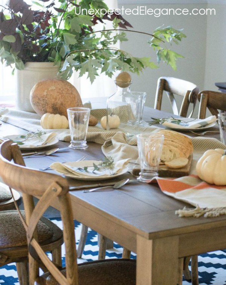 Chances are you'll be hosting a number of dinners throughout the fall season. If you want to make your dining room look gorgeous, you don't have to get fancy or spend a lot of money. There are simple tricks you can use to make your dining room look seasonal. Whether you use metallics or repurpose fall garland, there are inexpensive ways to decorate your dining room for fall.