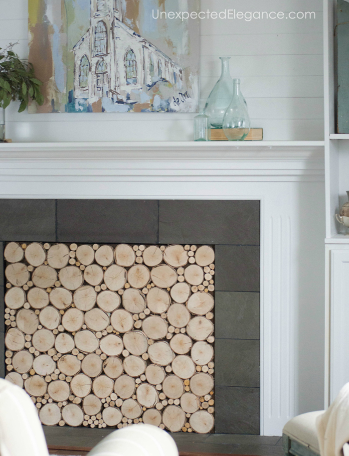Want to add interest to your fireplace? Get a quick and easy tutorial for creating a faux stacked log insert! It's also a great way to keep out drafts.