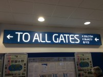A photo of a sign for airport gates