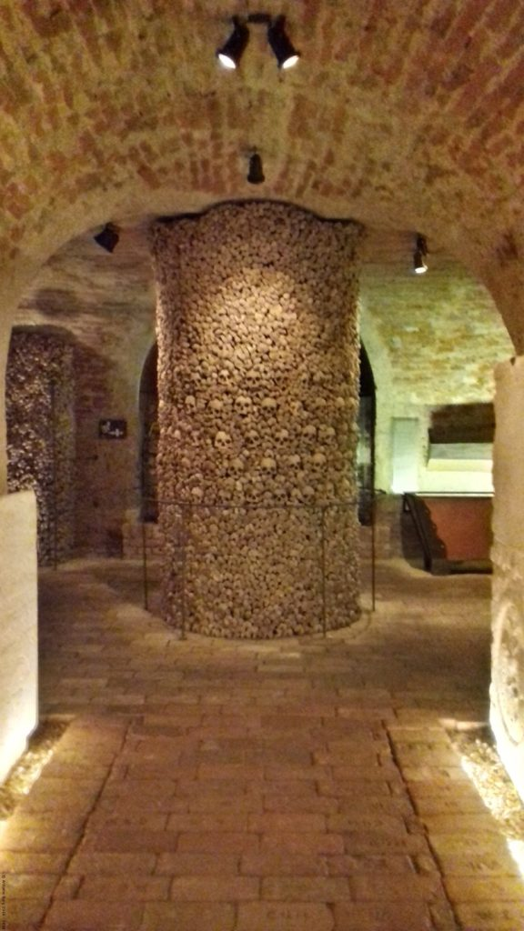 A photo of the central pillar in the Brno Ossuary - Brno, Czechia