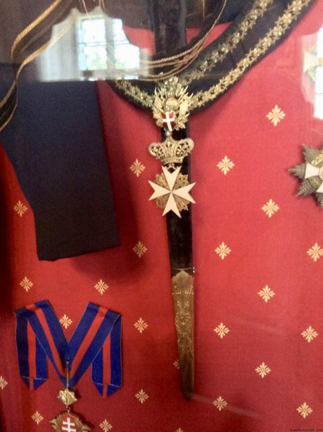 A photo of the family memorabilia, including the Cross of the Knights' of Malta - Karlova Koruna Zamek, Czechia