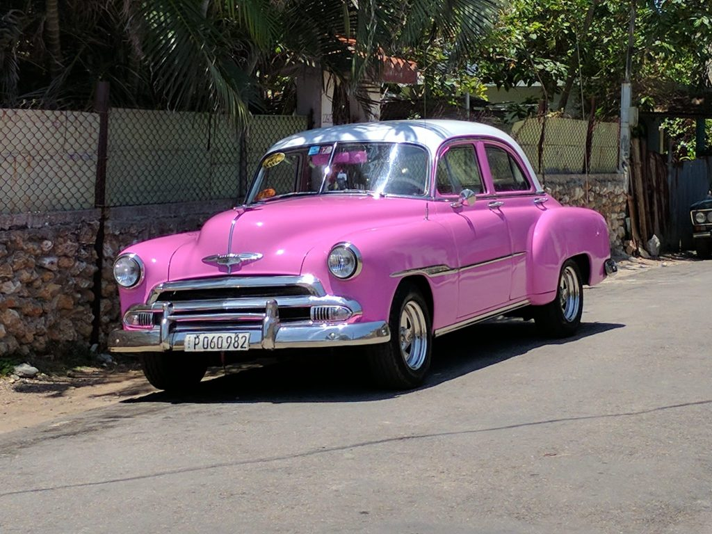 Hot Pink Car in Havana, Cuba on UnfoldAndBegin.com