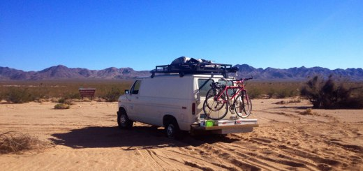camper van with bikes in desert