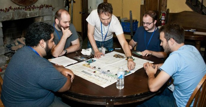 Seafall underwent extensive playtesting. Pictured here are designer, Rob Daviau (center), and Isaac Vega (left) and Colby Dauch (right) of Plaid Hat Games
