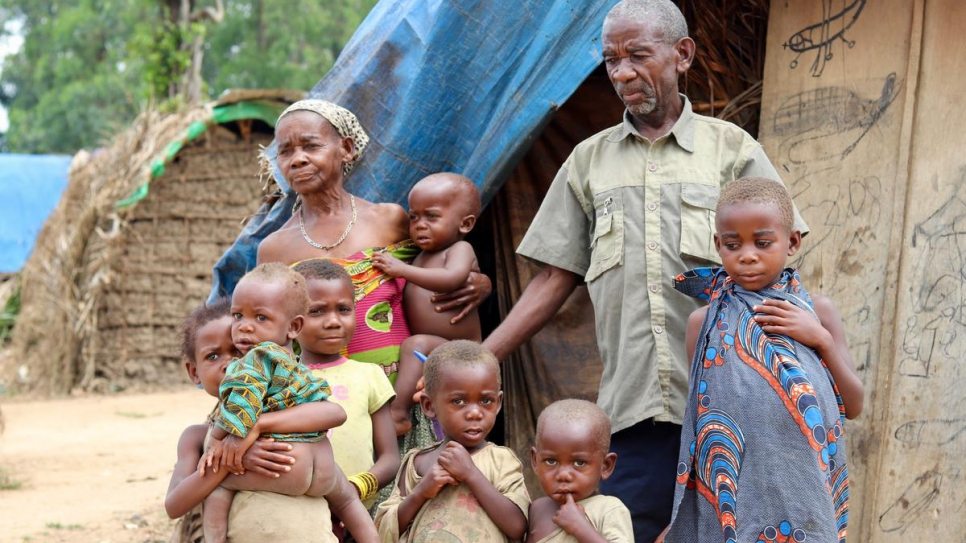 """Displaced mother Charlotte and her family at a makeshift site in Oicha. The family, who are Mbuti indigenous people, fled their lands in the so-called """"triangle of death"""" in North Kivu province."""