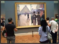"September 8: Photo taken with my iPhone at the Art Institute of Chicago, one of the great museums of the world. Dorette and I were there for a couple of hours last week during a break from the nearby jazz festival in Millennium Park. The painting is Gustave Caillebotte's ""Paris Street; Rainy Day,"" created in 1877 and acquired by the Institute in 1964, a year before I arrived in town to study at Northwestern's Medill School of Journalism. Admission then was free, so I often stopped by. Today, it costs $25 ($16 for ""seniors"") but worth every penny."