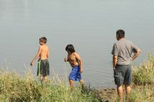 Before the protest. Boys playing in the Cannonball River.