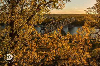 October 4: Fall colors surround the iconic Missouri River railroad bridge in Bismarck at sunset.