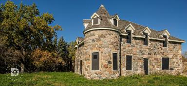 October 1: Coghlan Castle in Rolla, N.D., built by Scottish immigrants in the very early 1900s. The windows and doorways have been boarded up to prevent entry and damage.