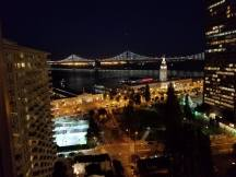 Night scene with East Bay Bridge in the background.