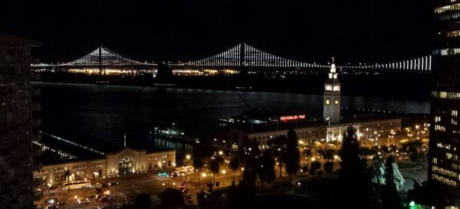 September 26: San Francisco sunset and East Bay Bridge at night.