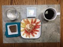 My traditional breakfast: full-fat plain Greek yogurt sprinkled with cinnamon, a honeycrisp apple, ½ piece of 100 percent sourdough rye bread, coffee, water and morning pills.