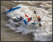 June 26: Trying not to drown in the Clark Fork River, Missoula. That's me in the red helmet. At least I wish it was.