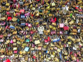 "June 12: Dorette and I first saw ""Cadenzas d'amour"" (love locks) attached to bridge railings when we visited Paris four years ago. Couples emblazon them with sentimental messages, lock them to a bridge grating, and toss the key into the Seine. The authorities tried to end the fad, but as this picture I took recently shows, it's still going on. Go figure."