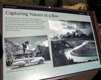June 21: Informational plaque on the spot where Ansel Adams took his image of the Snake River and Teton Mountain range. The photo of him standing on his car was taken in the Yosemite National Park. The photo on the right side is the image of the Snake River and the Teton Mountains that he took.