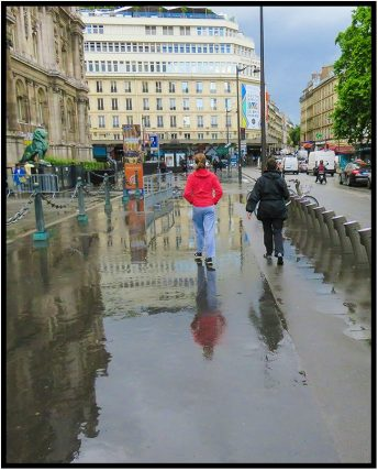 June 10: I prefer a sunny Paris, but even here rain, lightning and thunder must occasionally occur. Dorette Kerian and her grandaughter, Avery Dusterhoft, walking ahead of me had worn their wet weather jackets on this somewhat moist day. I, on the other hand, needed to put down my umbrella to take this shot.
