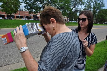Several parents with children brought simple handmade devices to view the eclipse.