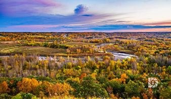 """Pembina Gorge Sunset"": I took a wide shot of the Pembina Gorge with the river winding around the colorful fall trees foliage."