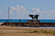 The indomitable Spanish steer sculpture outlined by the deep blue Mediterranean and light blue sky.