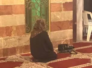 Muslim woman prays at the mosque at the site of Abraham's tomb.