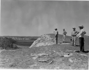 Four men looking at Sand Creek station location on the Fort Keogh Trail. (Photo courtesy of TRNP and the TR Center.)