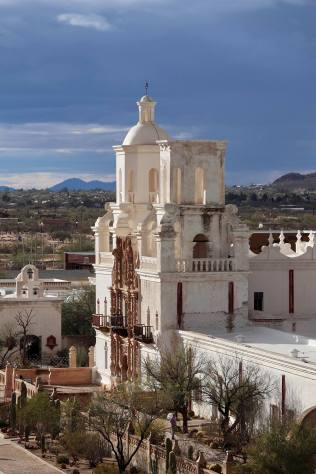 The sun comes out and lights up the San Xavier Mission, built by the Spanish in 1797.