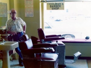 The picture window was more for looking in than out in small-town barbershops. A barber's best advertisement to the world was what was going on inside.