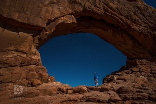 We were out at Window Arch late at night when we heard someone walking up the trail. Turned out is was a young gentleman from Arizona who was camping there waiting for some friends to show up that night. I asked if he wanted a photo of himself standing in the Arch and he agreed. Gives you scale on how large this arch is. The moon light lit the scene up and a nice window of stars on the other side.