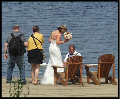 Bride, Groom and tourists share the dock before the wedding, Minnesota North Country style.