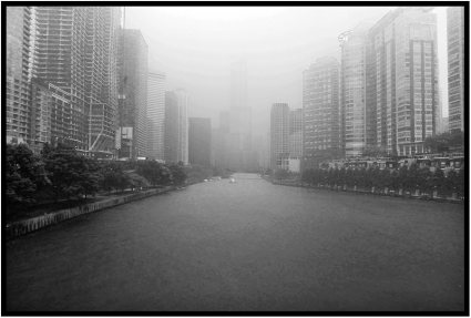 The Chicago River on a day of light rain and mist.