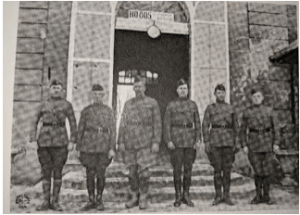 Maj. Bliss, in front of HQ805, is third from right.