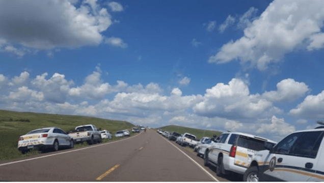 Running the gauntlet of law enforcement vehicles along Highway 1806 on Day 1 of the DAPL protests , Aug. 12, 2016.