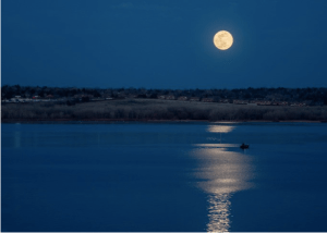 My friend, Greg Ness, sent me this wonderful photo of the moonrise over a Colorado lake Tuesday night.