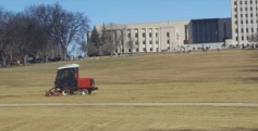 The guys mowing the Capitol lawn just kept right on working, oblivious to what was going on up top.