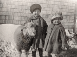 Lauretta (left) and Junette with their ewe. Stylish even as tiny tots.