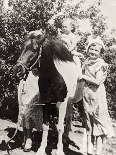 Junette with my mother, Marian (on the horse). Lauretta obscured. Again, stylish hats.