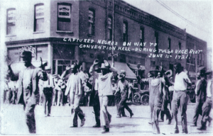After the burning, Greenwood residents herded into dentention camps before jeering white crowds.