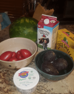 aco fixins', watermelon and milk from Thursday's trip to the Food Co-op. Hamburger is in the freezer, and lettuce is in the garden.