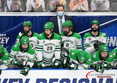 March 27, 2021 North Dakota head coach Brad Berry watches play on the ice during the championship game of the NCAA men's hockey Midwest Regional between the University of Minnesota - Duluth Bulldogs and the University of North Dakota Fighting Hawks at Scheels Arena, Fargo, ND. The game went to 5 overtimes and is the longest game ever played in NCAA tournament play. Minnesota Duluth won 3-2 and moves on to the Frozen Four. Photo by Russell Hons/CSM