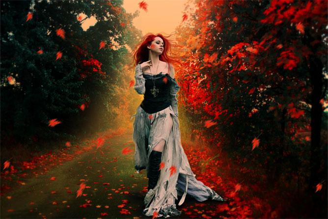 Lány az őszi lombhullásban.