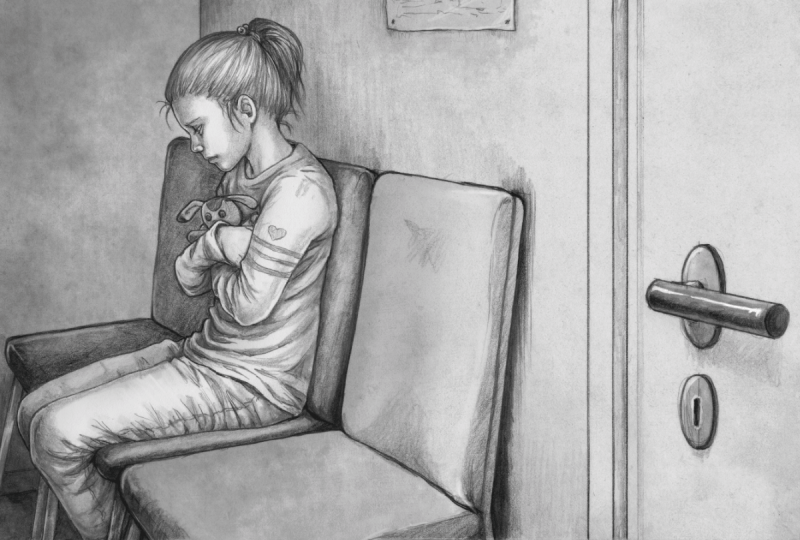 A young child sitting alone in a waiting room clutching a stuffed animal