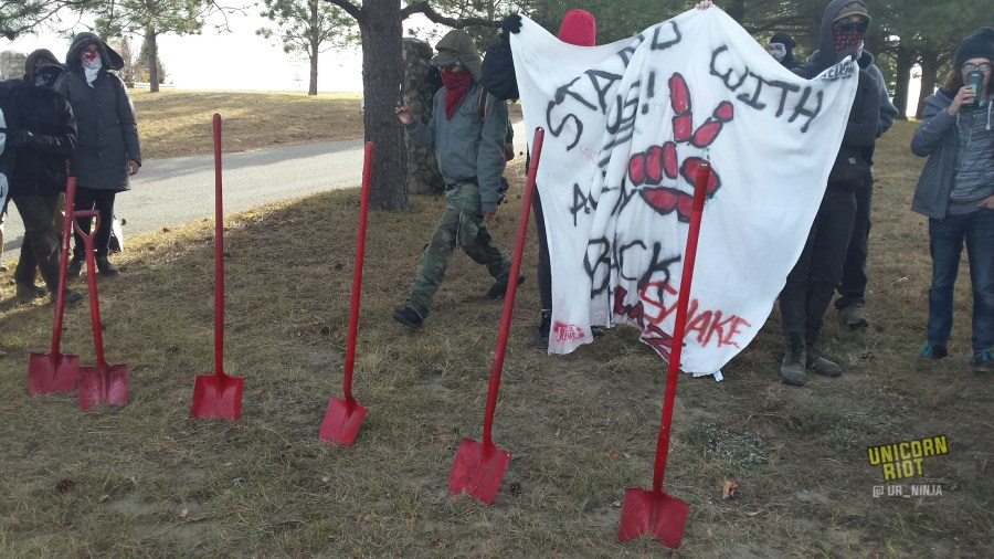 Red shovels were displayed at the cemetery demonstration.