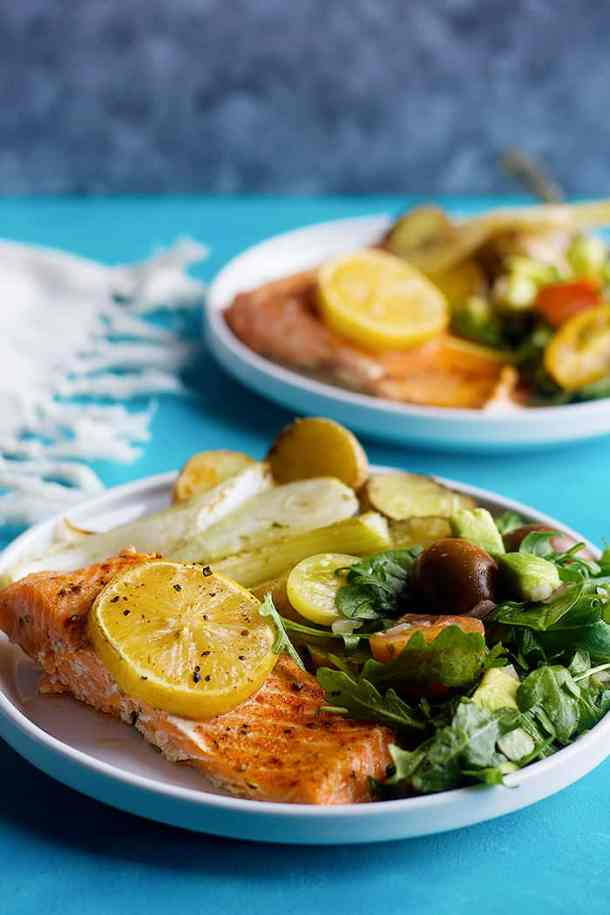 healthy baked salmon recipe with an arugula avocado salad.