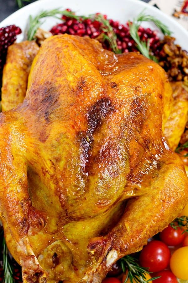Delicious juicy turkey with spices and herbs that's perfect for Thanksgiving.