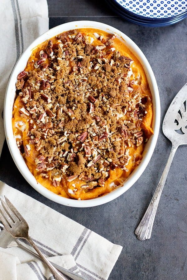 This classic Sweet Potato Casserole is a must-have for Thanksgiving. It's easy, fluffy and perfectly sweet.And, pecans add just the right amount of crunch!