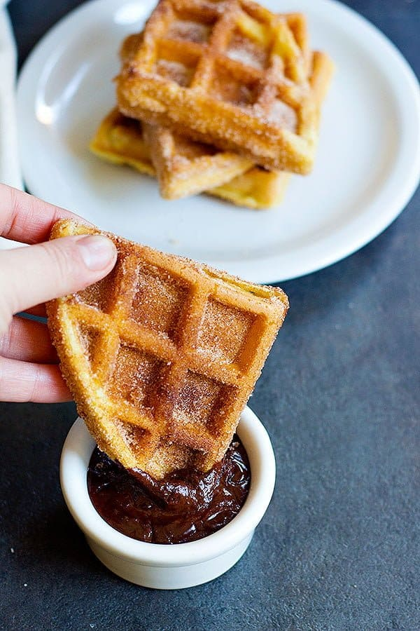 Churro Waffles are delicious fluffy waffles full of cinnamon sugar, served with some delicious chocolate!