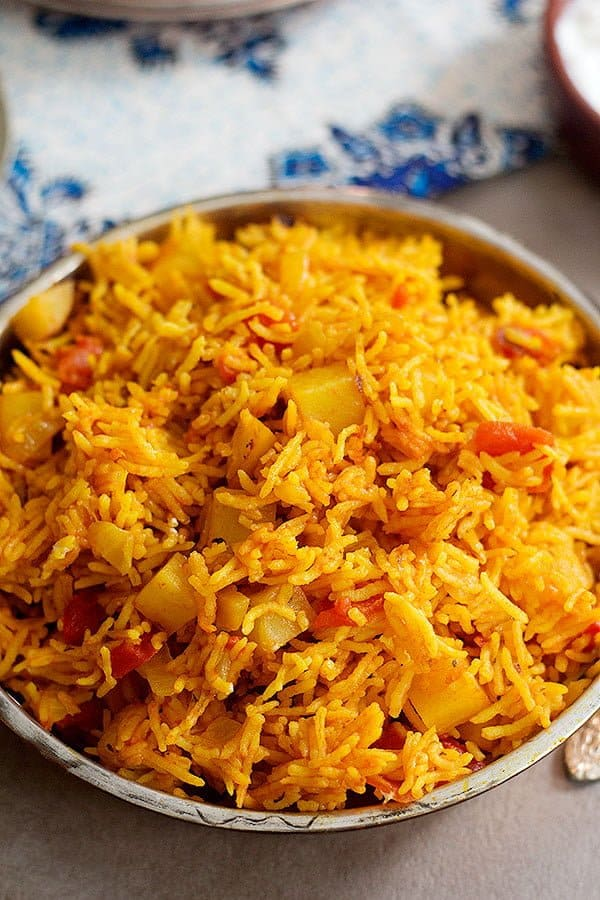 Persian Red Rice recipe known as Dami Gojeh Farangi is a simple Persian dish that is made in less than an hour.